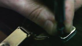 Man twists wood screws stock video footage