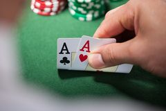 Man with two aces in casino Royalty Free Stock Photo