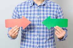 Man with two arrows pointing to the right and left Stock Photography
