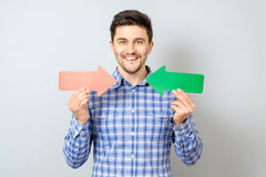 Man with two arrows pointing to the right and left Stock Image