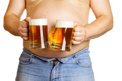 Man with two beer mugs stock photo