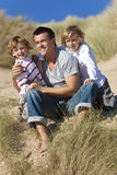 Man & Two Boy, Father and Sons Having Fun At Beach Stock Photos