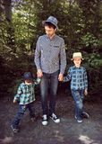 Man With Two Boys royalty free stock photography