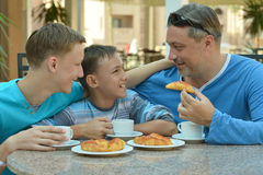 Man and two boys having breakfast Royalty Free Stock Photography
