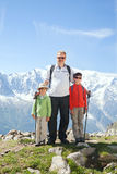 The man with two boys in a mountain hike Stock Image