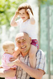 Man with two children Royalty Free Stock Images