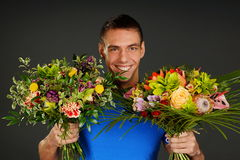 Man with two flowers Royalty Free Stock Image