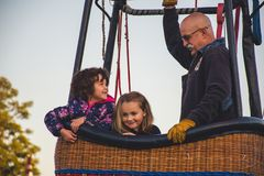 Man and Two Girls Riding on Hot Air Balloon stock photo