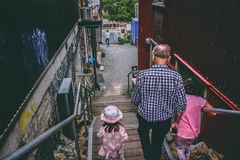 Man and Two Girls Walking Down on Stairs Stock Image