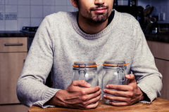 Man with two jam jars Stock Photos