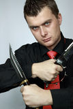Man with two knifes in hands Stock Image