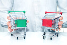 Man with two miniature trolleys. Stock Images