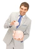 Man with two piggy banks. Picture of handsome man with two piggy banks Royalty Free Stock Images