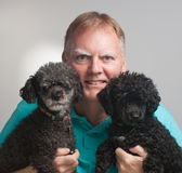 Man two poodles Stock Image