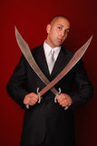 Man with two Samurai swords. Stock Photo