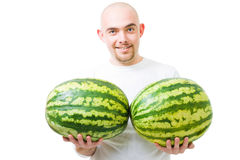 Man with two watermelons show double growth Royalty Free Stock Images