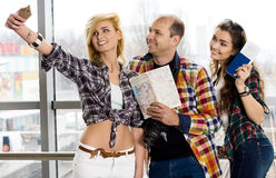 Man and two woman holding a passport with tickets and a map and photographed.Europeans. Gathered in a guided tour Stock Image