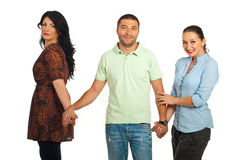 Man between two women stock photography