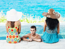 Man and two women Stock Photography