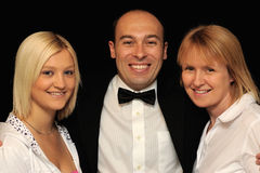 Man with two women Stock Images