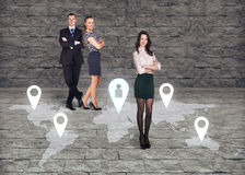 Man and two women close by each over on earth map Royalty Free Stock Photography
