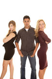 Man between two women hands in pockets Royalty Free Stock Photography