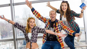 Man and two women happy, happiness raised hands and looking into the camera. Europeans. Gathered in a guided tour. Royalty Free Stock Images