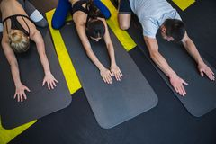 Man with two women are practicing pilates in studio Stock Photography