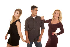 Man between two women smile Stock Photo