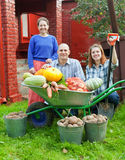 Man and two women with   vegetables in garden Royalty Free Stock Photography