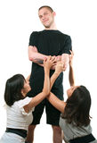 Man and two young women. The men and two young women on white background Royalty Free Stock Photography
