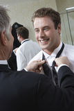 Man Tying Groom's Bow Tie Royalty Free Stock Images