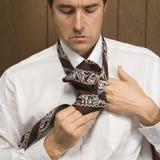 Man tying his necktie. Stock Photos