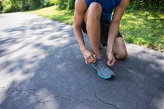 Man Tying His Shoelace Royalty Free Stock Images