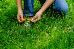 Man tying his shoelaces on his sneakers Royalty Free Stock Photography