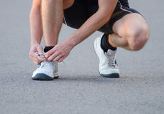Man tying his shoes. Man tying his sport shoes Stock Photo