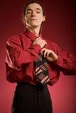 Man tying his tie Stock Photo