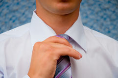 Man tying his tie itself. Royalty Free Stock Photography