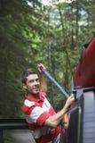 Man Tying Kayak On Car Roof  Royalty Free Stock Photo