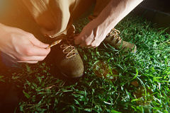 Man tying laces on his shoes Stock Images