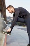 Man tying laces before training Stock Photo