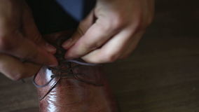 Man tying patent leather shoes formal and festive dressing. Man tying patent leather shoes formal and festive dressing stock footage
