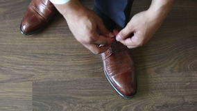 Man tying patent leather shoes formal and festive dressing. Man tying patent leather shoes formal and festive dressing stock video footage