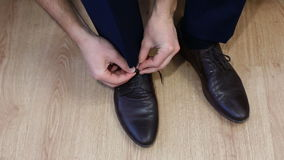 Man tying patent leather shoes formal and festive dressing. stock video footage