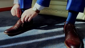 Man tying patent leather shoes. stock video footage