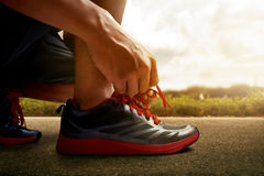 Man tying running shoes. Man tying his running shoes Stock Photo
