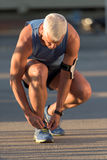 Man tying running shoes laces. Before jogging workout Royalty Free Stock Image