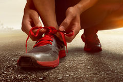 Man tying running shoes. Prepare to run stock photos