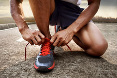 Man tying running shoes. Prepare to run royalty free stock photos