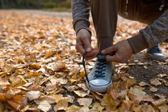 Man tying shoe laces before running outdoors. Stock Photos